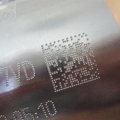 Data matrix code created by a needle embossing system